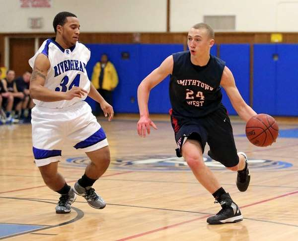 Smithtown West's Matt Misser drives past Riverhead's Malik
