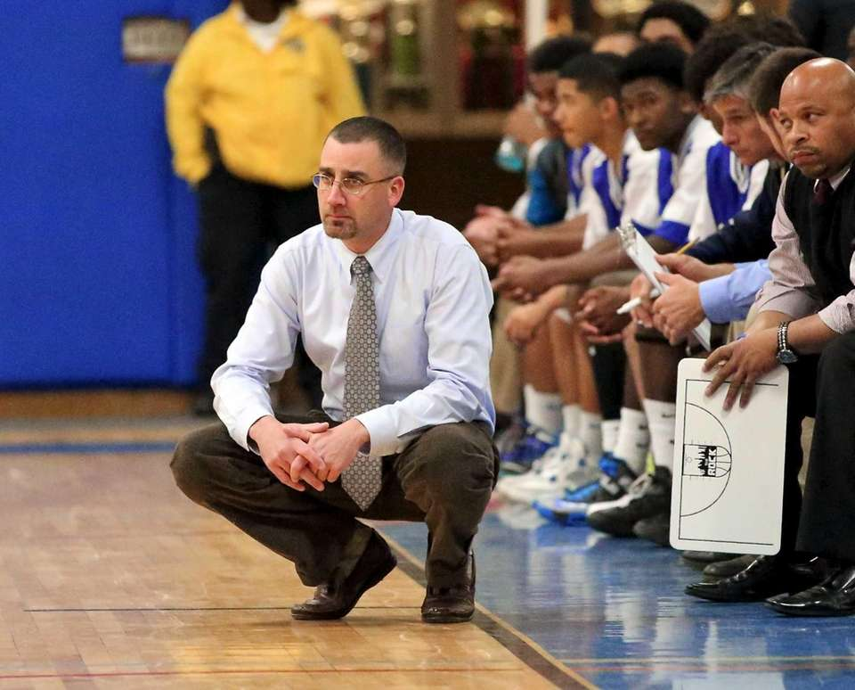 Riverhead coach John Rossetti watches his team in