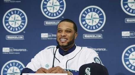 Robinson Cano talks to reporters after he was
