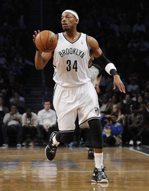 Nets forward Paul Pierce controls the ball against