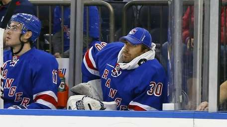 Henrik Lundqvist of the Rangers sits on the