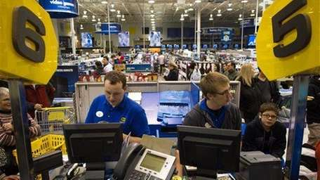 Employees ring up purchases at Best Buy in