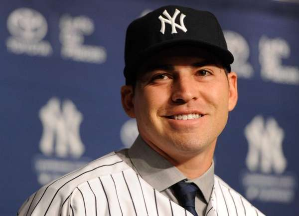 Jacoby Ellsbury looks on during his introductory press
