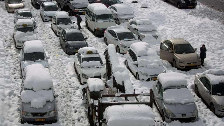 Vehicles are stranded in snow at the entrance