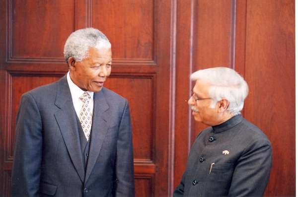 Former South African President Nelson Mandela, left, receives