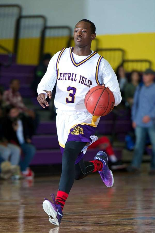 Central Islip guard David McKenzie takes the ball