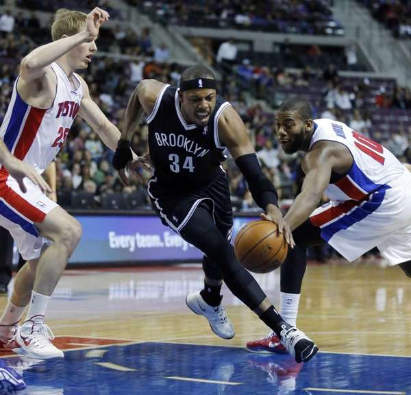 Nets forward Paul Pierce drives to the basket