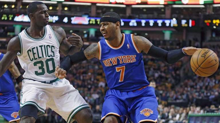 Knicks' Carmelo Anthony keeps the ball away from