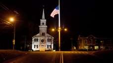An American flag flies at half-staff on Main