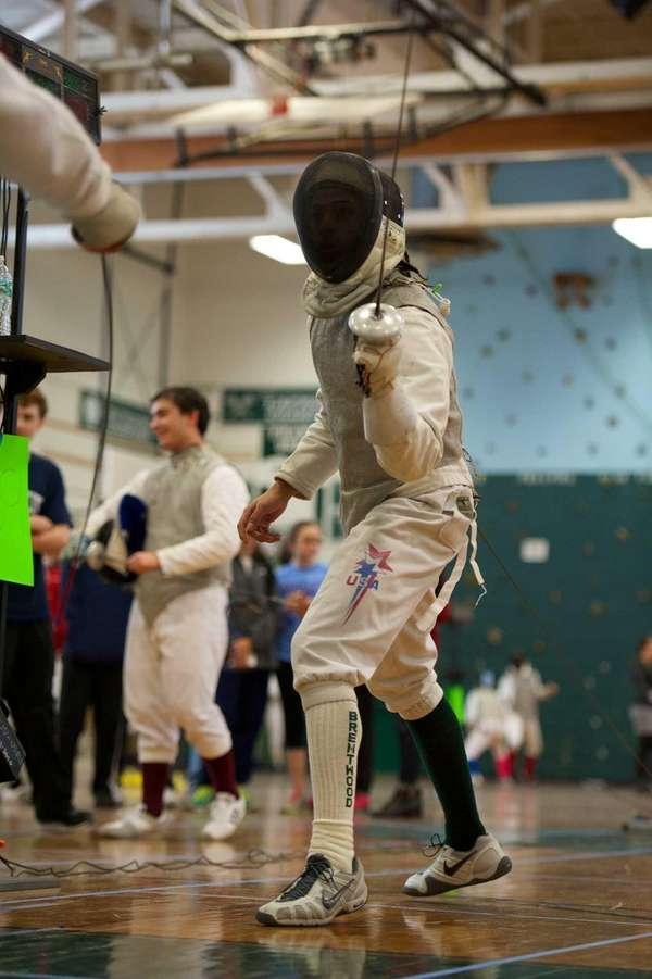 Brentwood fencer Julian Priceman competes against Great Neck