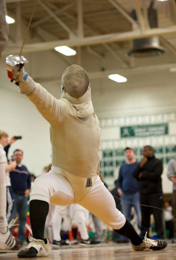 Commack fencer Brian Huang competes in boys sabre.