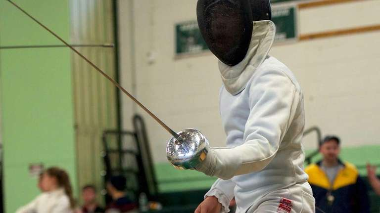 Great Neck South fencer Skyler Chin competes in