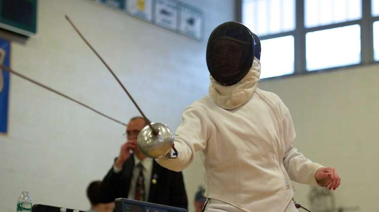 Ward Melville fencer Melanie Holl competes in the