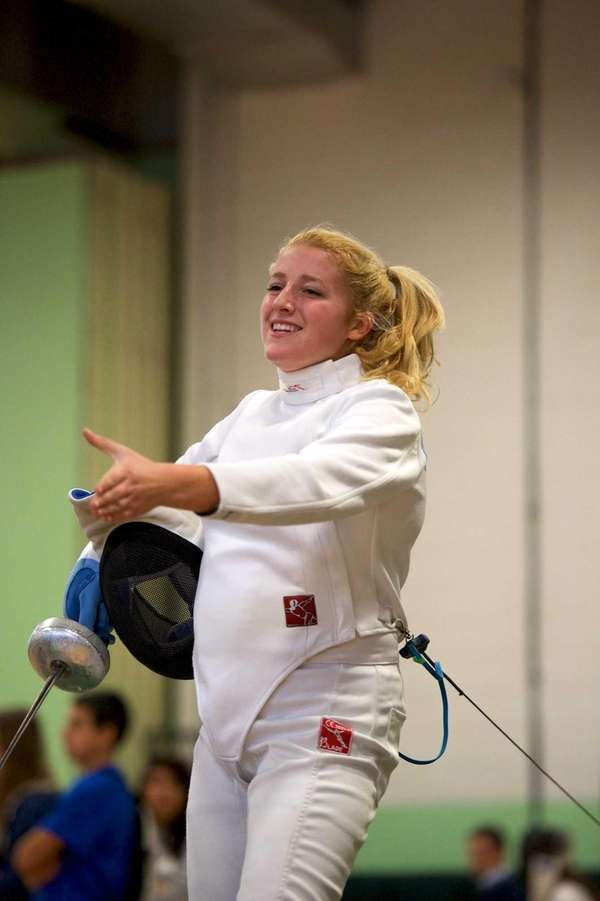 Oyster Bay fencer Grey Warwick-Clark smiles after winning
