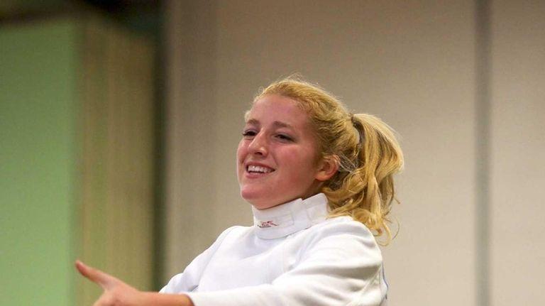 Oyster Bay fencer Grey Warwick-Clark smiles after winning