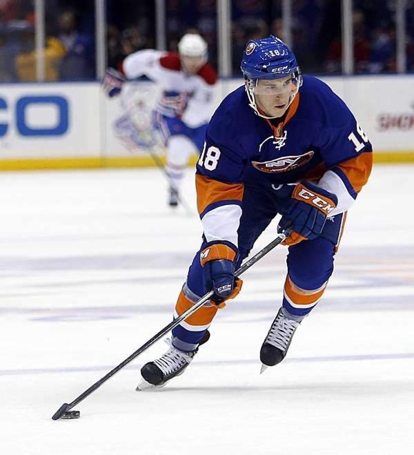 Islanders center Ryan Strome brings the puck up