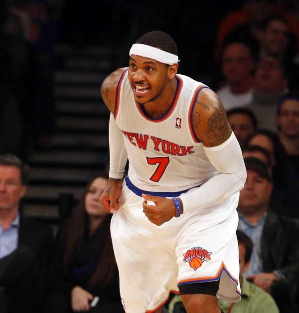 Carmelo Anthony of the Knicks reacts after scoring