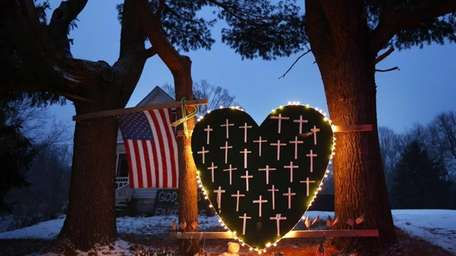 A makeshift memorial with crosses for the victims