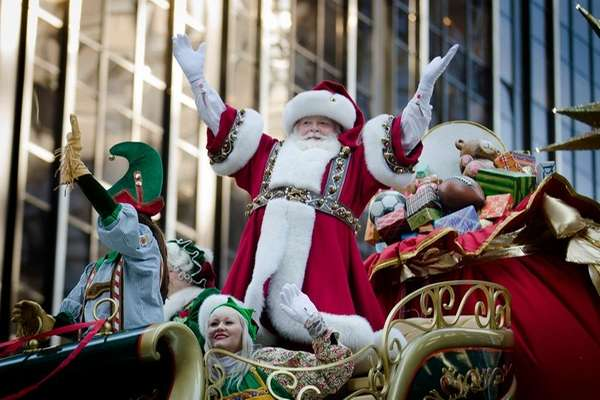 Santa Claus waves to the crowd during the