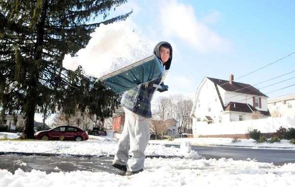 Michael Dominick, 17, shovels snow off the driveway