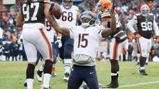 Chicago Bears wide receiver Brandon Marshall signals touchdown