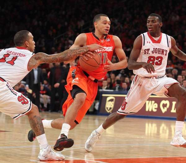 Syracuse Orange guard Tyler Ennis is fouled by