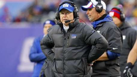 Tom Coughlin looks on during the second half