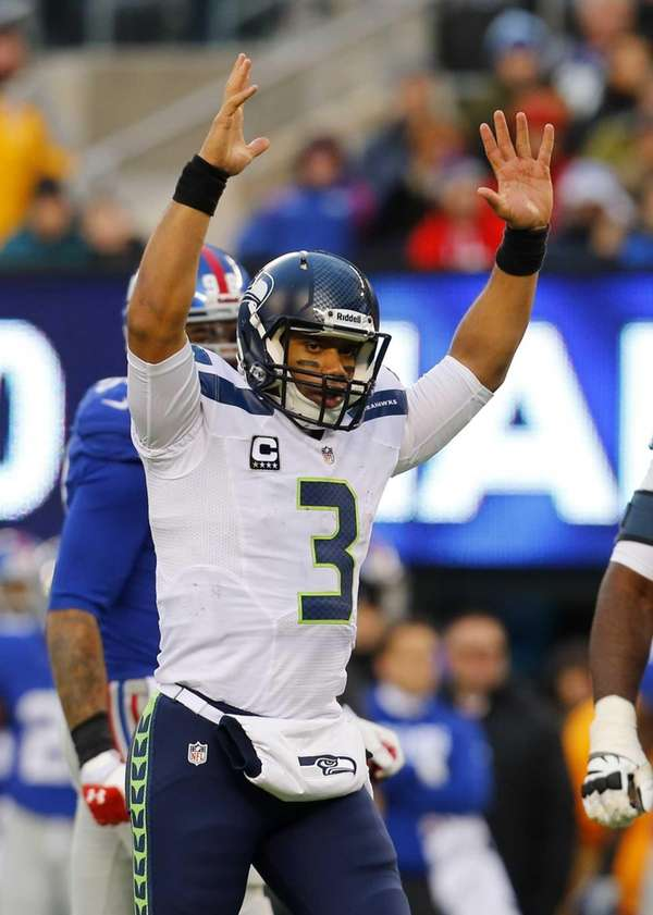 Seattle Seahawks quarterback Russell Wilson celebrates after throwing