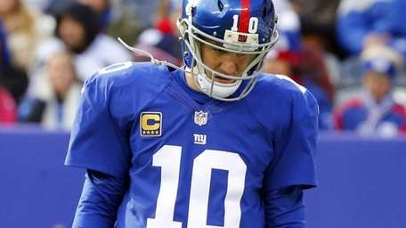 Eli Manning looks on during the first quarter