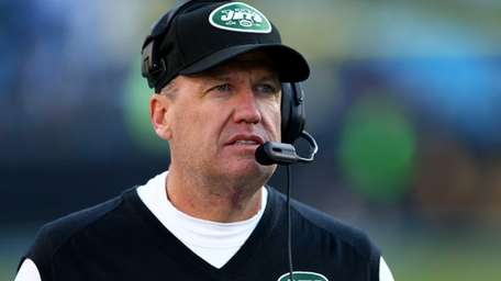 Rex Ryan looks on during a game against