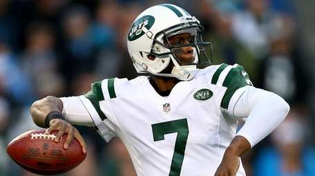 Geno Smith drops back to pass against the