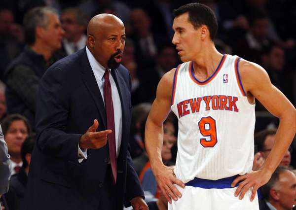 Head coach Mike Woodson talks with Pablo Prigioni