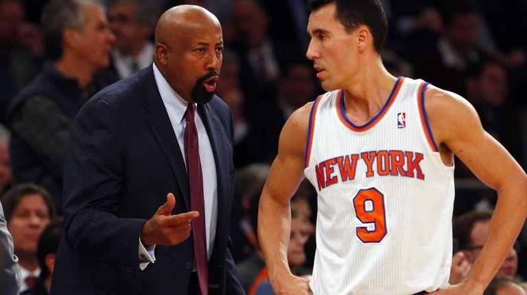Head coach Mike Woodson talks with Pablo Prigioni