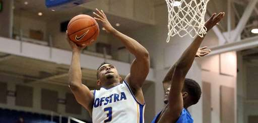 Hofstra's Zeke Upshaw (3) puts in the basket