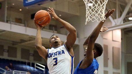 Hofstra's Zeke Upshaw (3) puts in the basket