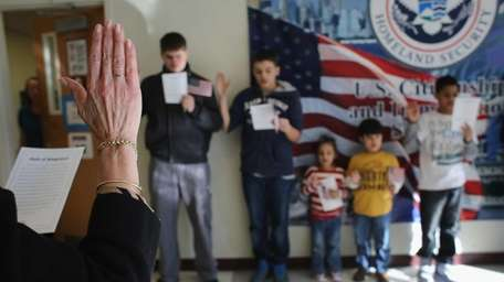 Children participate in a U.S. citizenship ceremony at