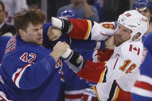 The Calgary Flames' Brian McGrattan (16) lands a