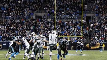 The Carolina Panthers' Jason Williams (54) blocks a