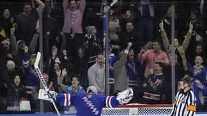 Henrik Lundqvist reacts after stopping a shootout shot