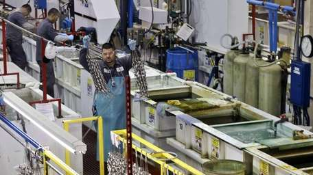 Employees at Sheffield Platers work on the factory