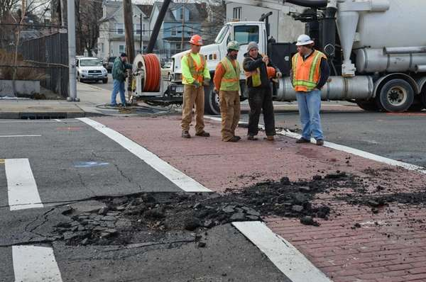 Contractors from Laser Industries work on Franklin St.