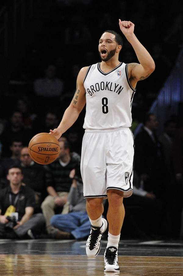 Deron Williams calls a play against the Philadelphia