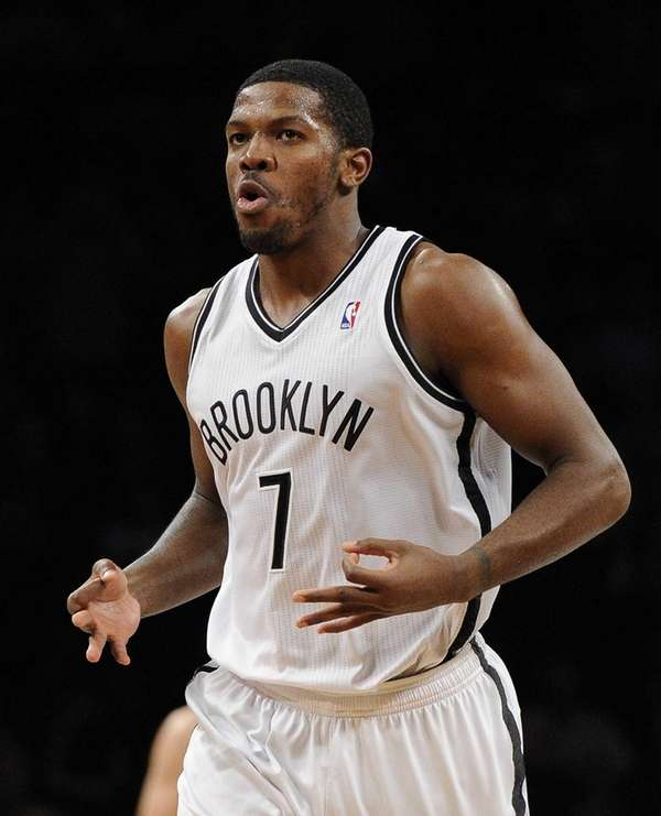 Joe Johnson reacts after sinking one of his