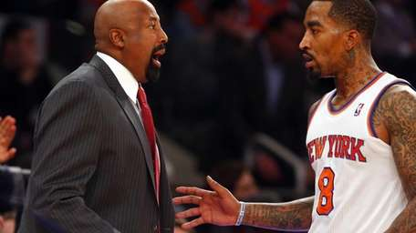 Mike Woodson of the Knicks talks with J.R.