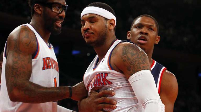 Carmelo Anthony and Amar'e Stoudemire react to a