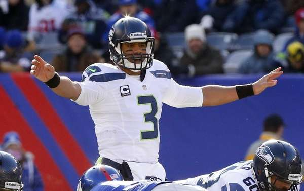 Seattle Seahawks quarterback Russell Wilson calls a play