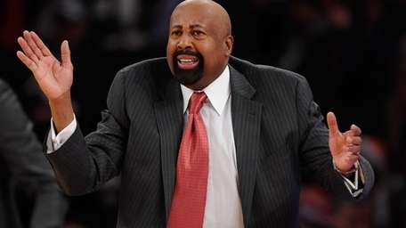 Mike Woodson directs his team during the second