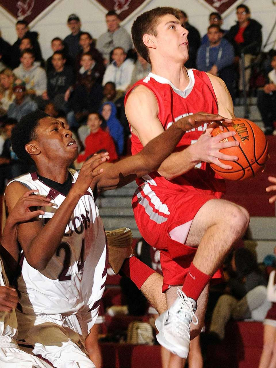 East Islip's Brandon MacMorris, right, draws a foul
