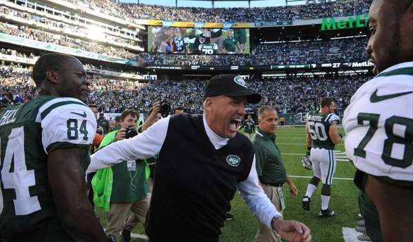 Stephen Hill (84) and Rex Ryan celebrate after