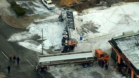 An aerial view of an overturned tanker truck